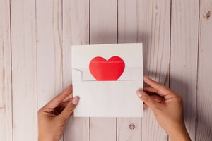 white and red heart print card