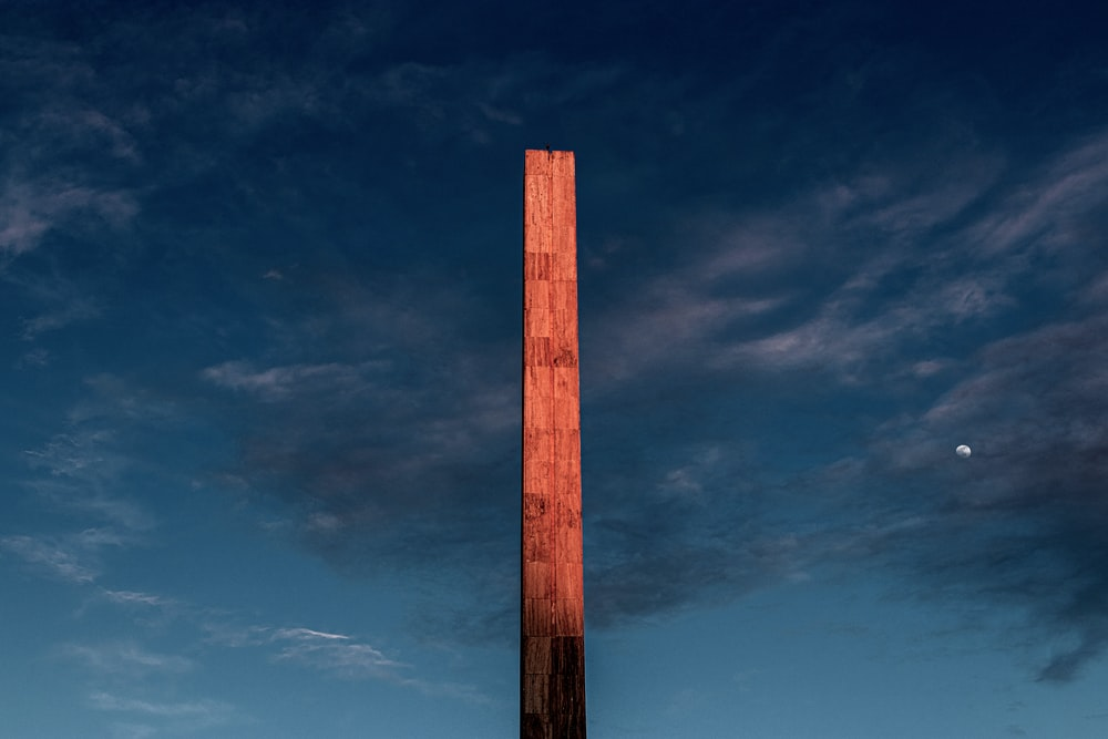 brown wooden post under blue sky