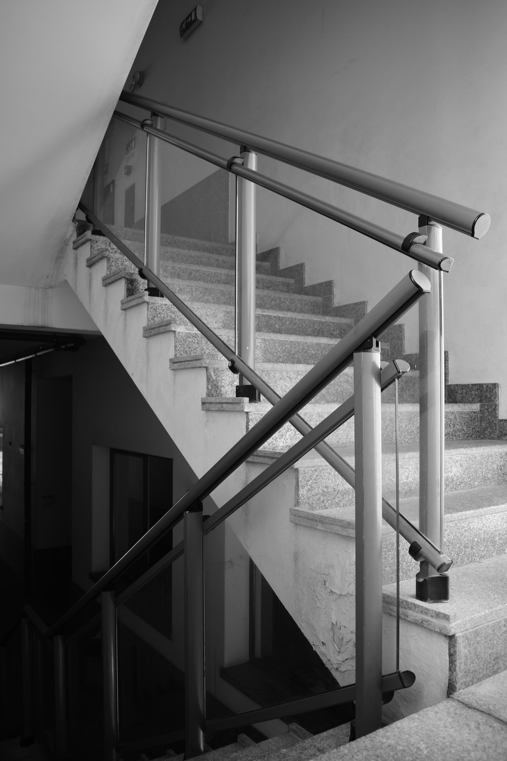 grayscale photo of a metal staircase