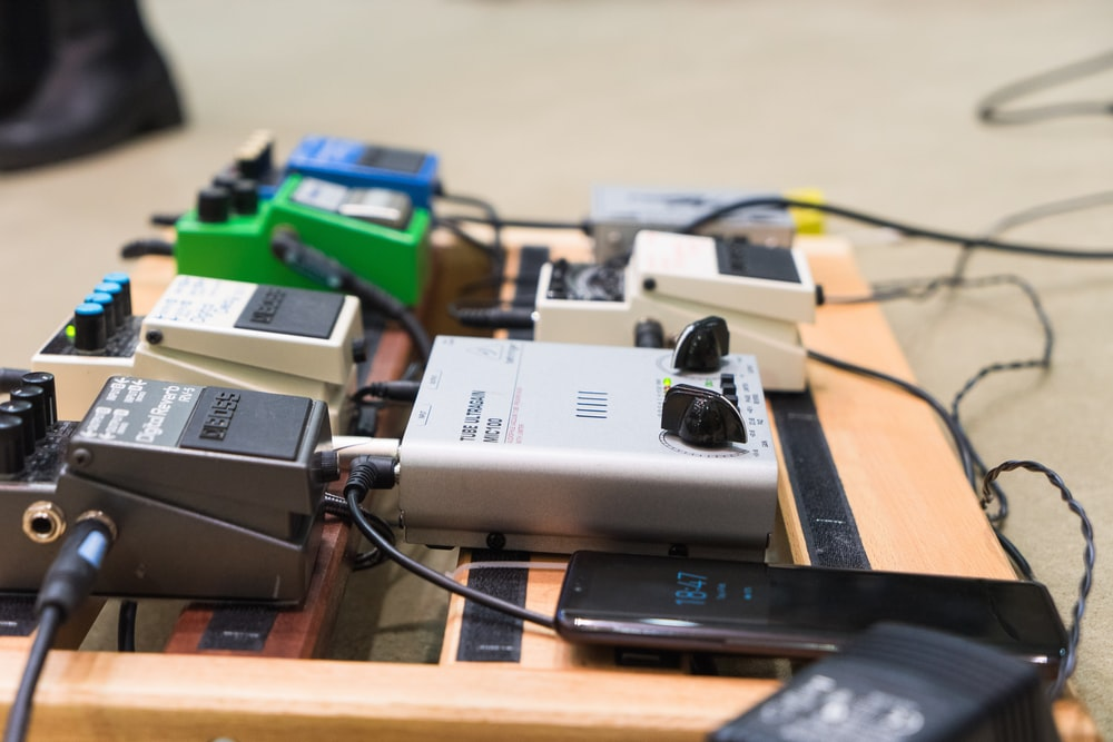 gray and black electronic devices on brown wooden table