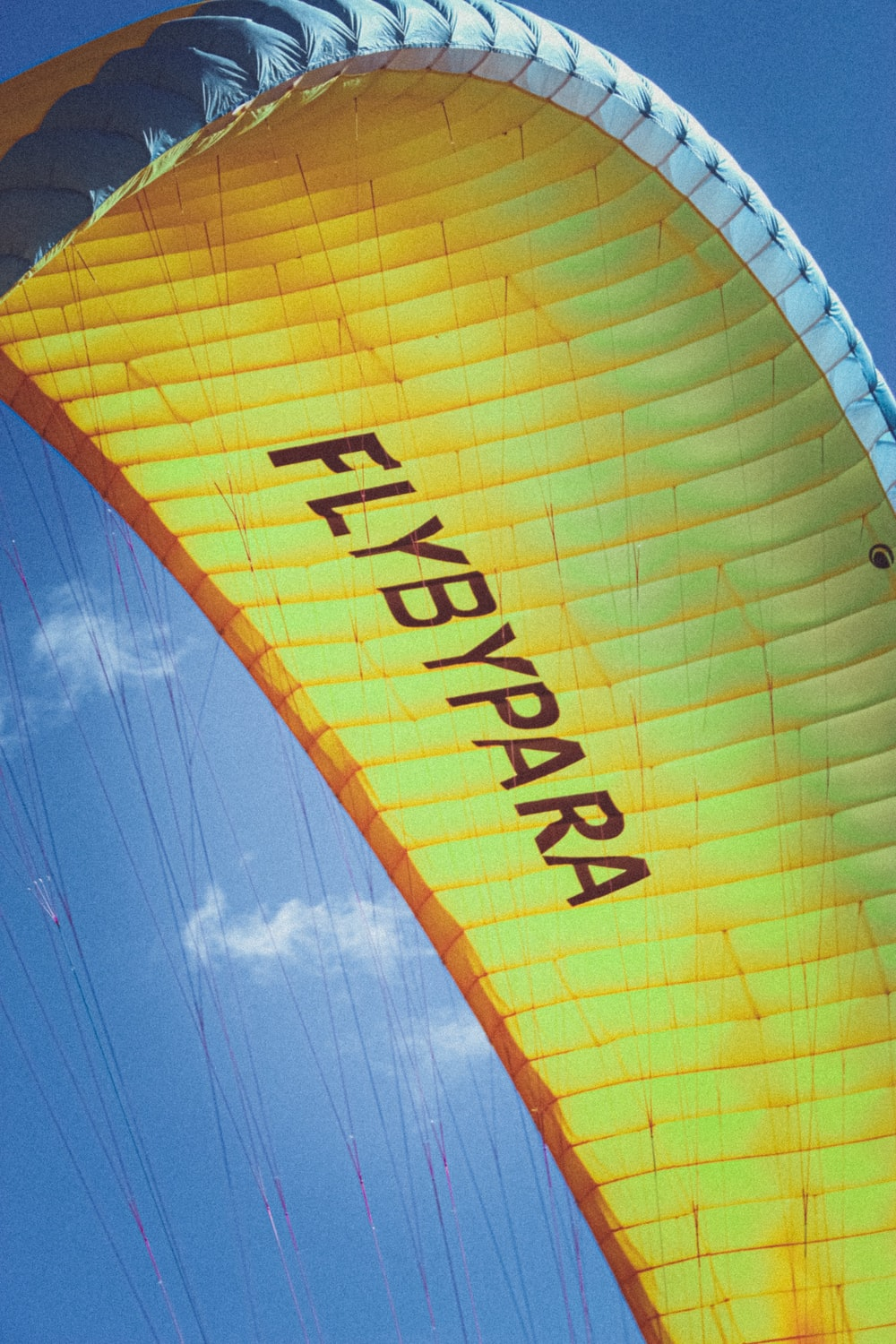 yellow and red hot air balloon under blue sky during daytime