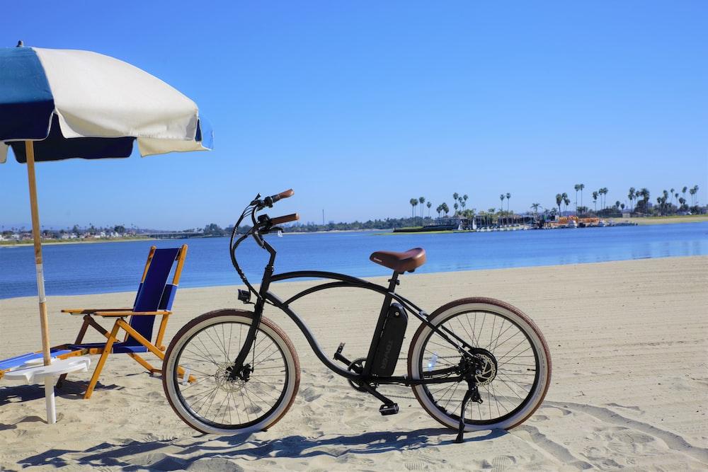 black bicycle on beach during daytime