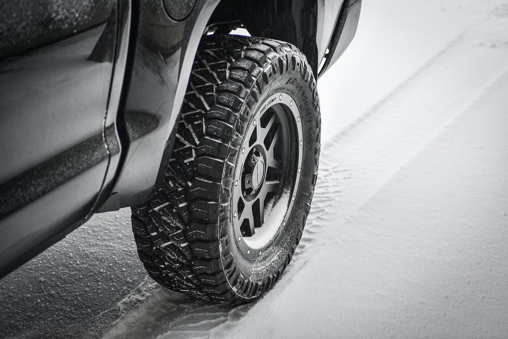 grayscale photo of car wheel