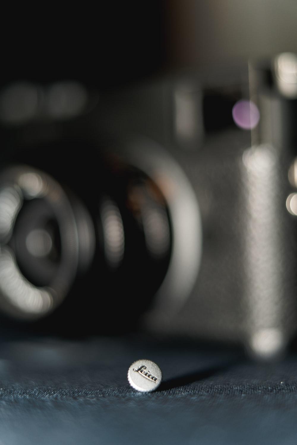 black camera lens on blue textile