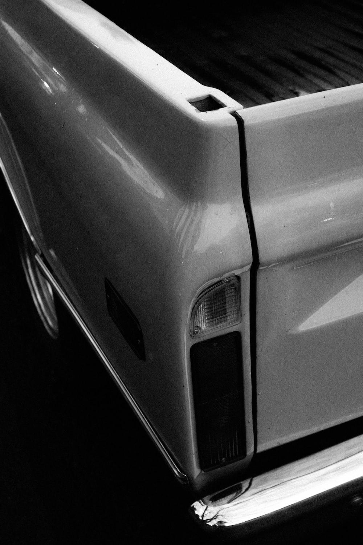 grayscale photo of car door