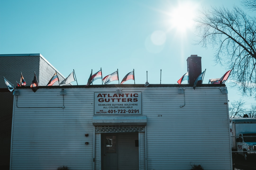 Flags blowing on a gutter shop.