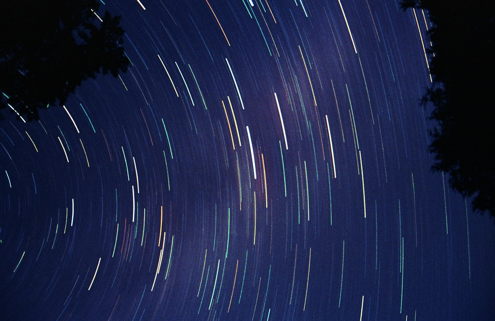time lapse photography of stars in the sky during night time