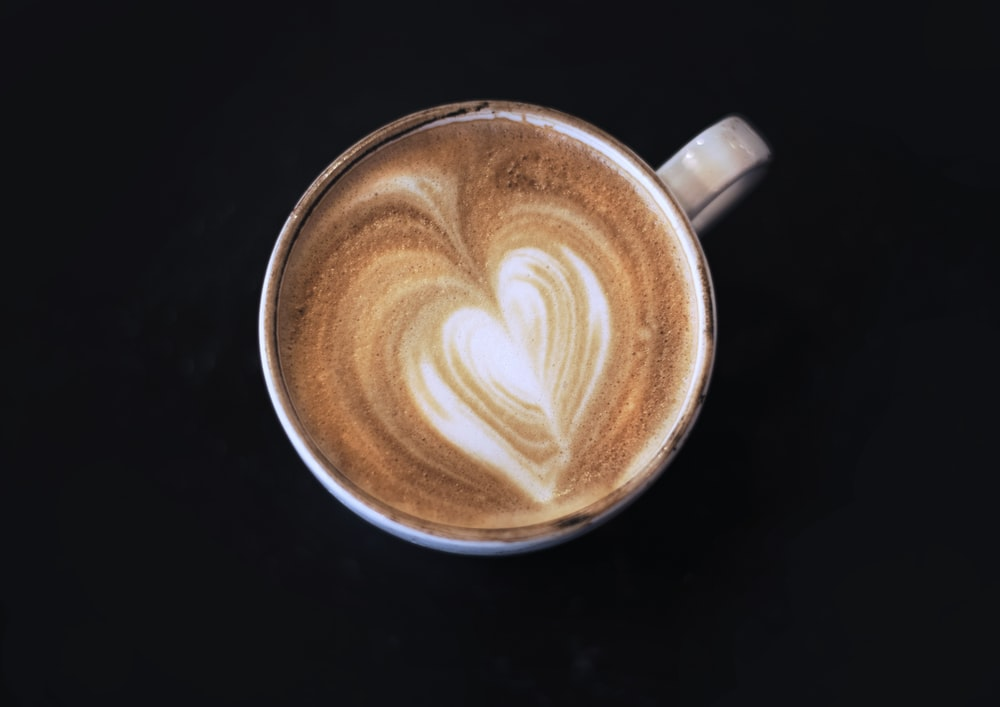 brown and white ceramic mug with coffee