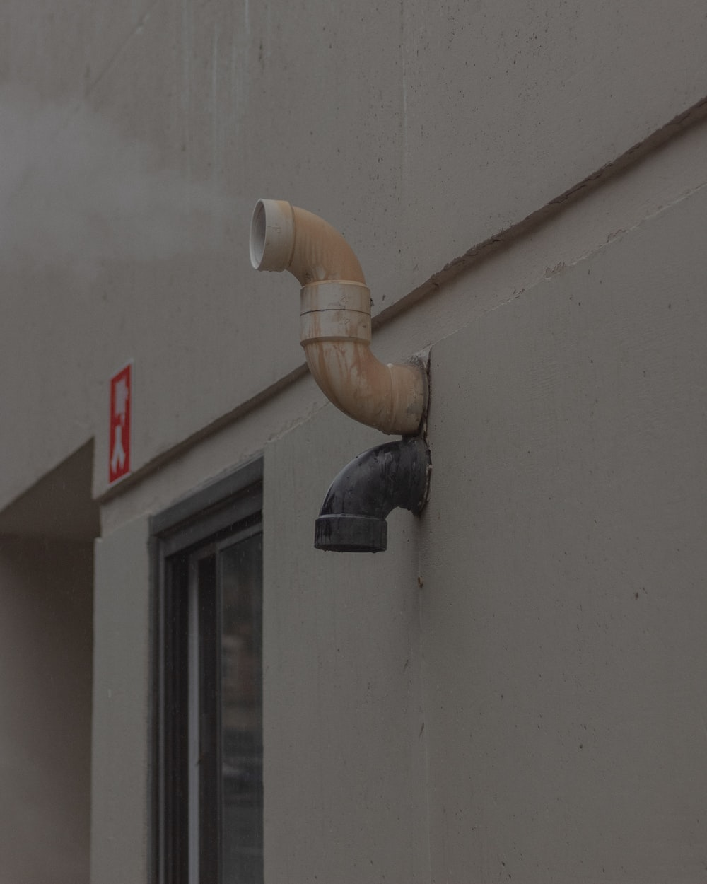 white and brown pipe mounted on white wall