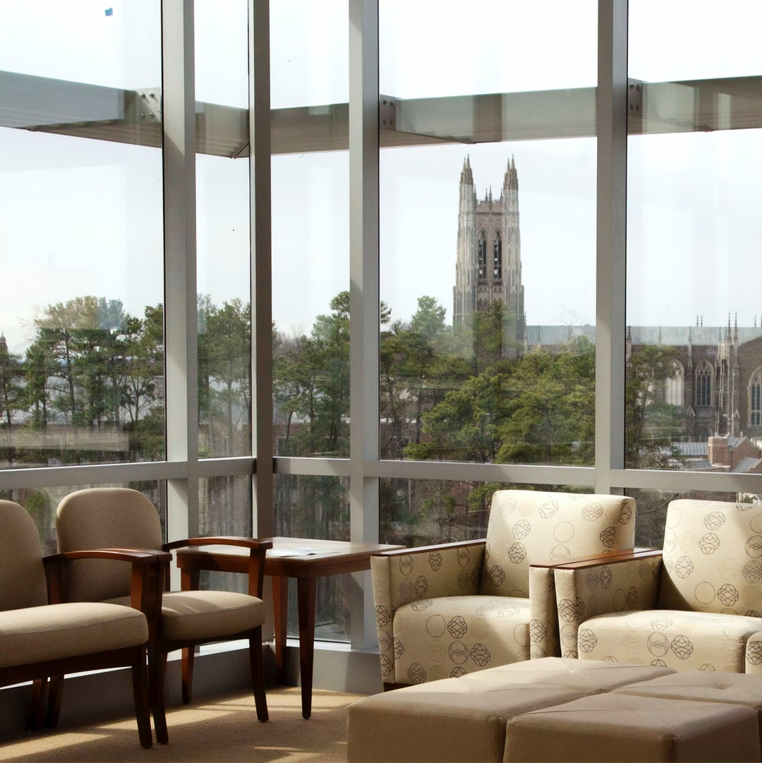 The iconic spires of Duke Chapel as seen through the window of one of the waiting rooms at the Duke Cancer Institute in Durham, North Carolina. In 1972, the Duke Comprehensive Cancer Center, now known as the Duke Cancer Institute, was established and designated by NCI as one of the first comprehensive cancer centers.
