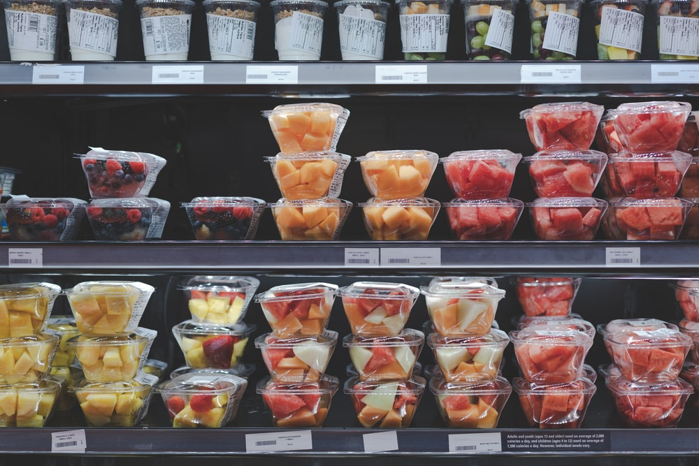 assorted fruits in plastic containers