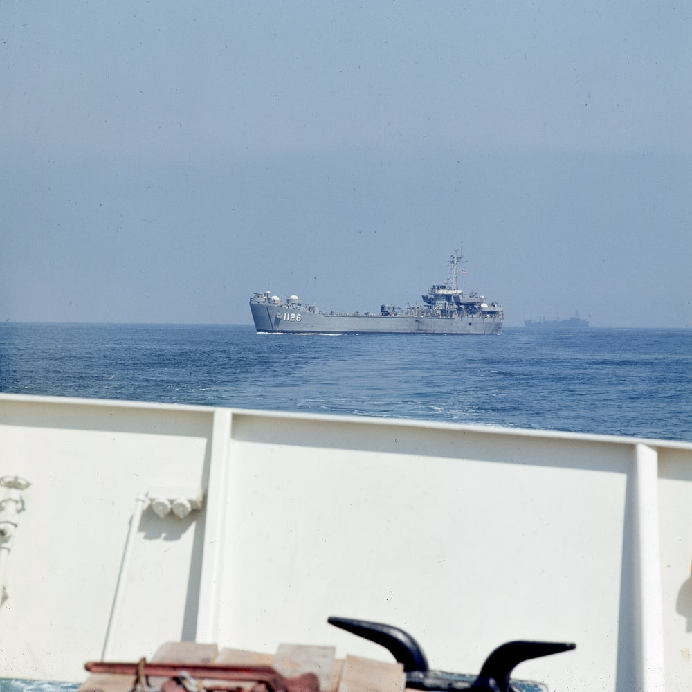 white and black ship on sea during daytime