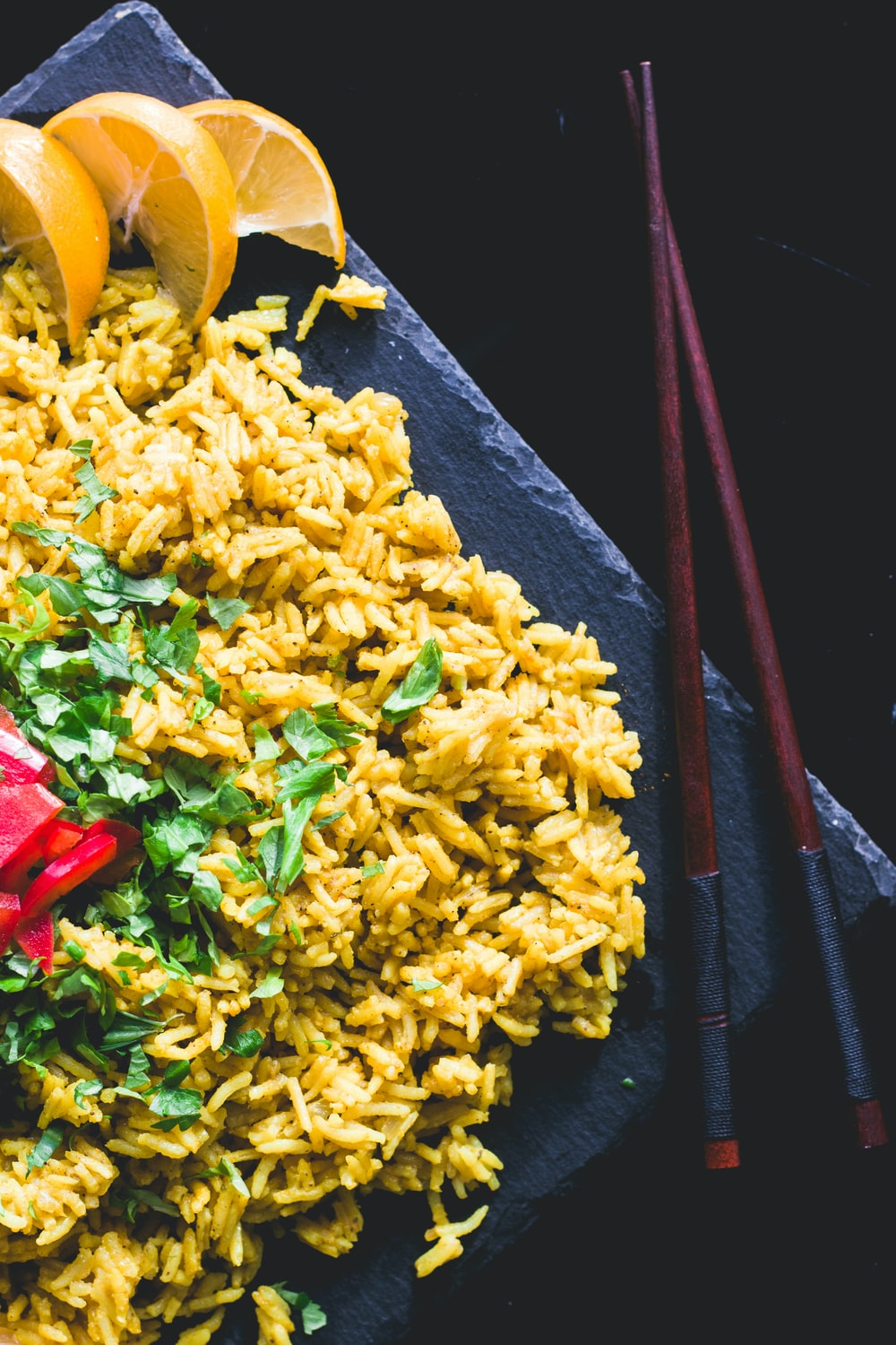 yellow rice with red rose petals