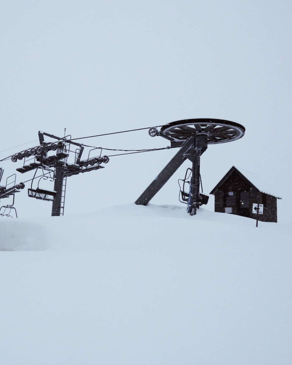 black and white windmill on snow covered ground