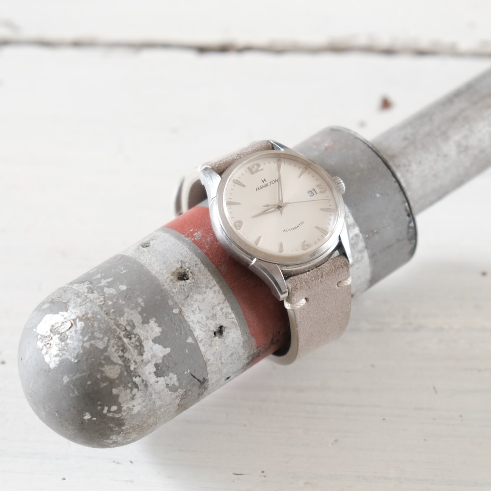 silver and red steel pipe