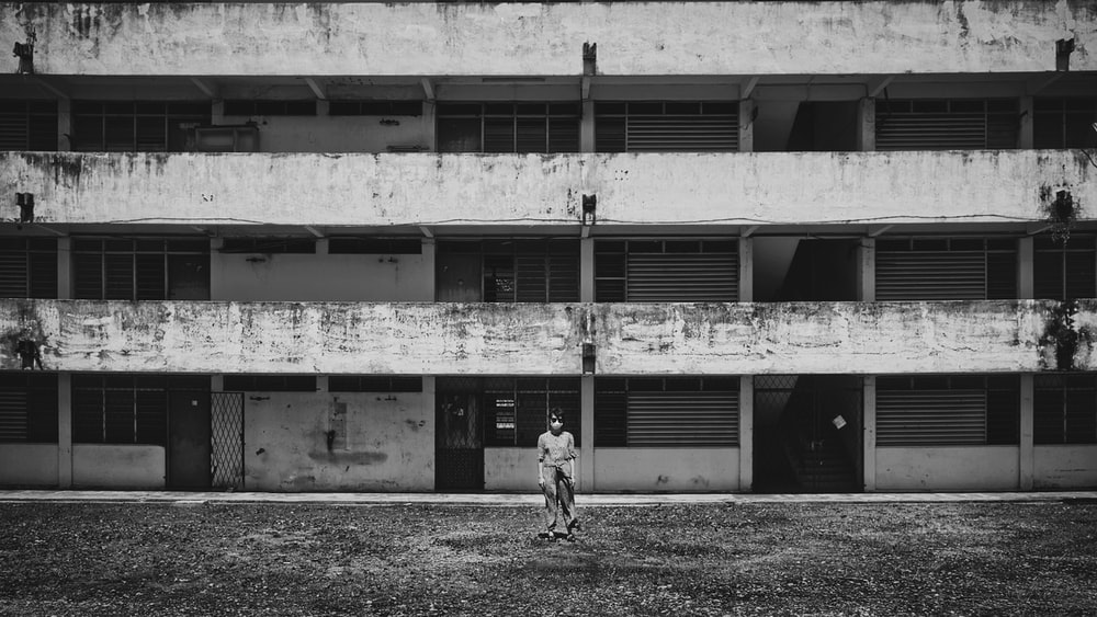 grayscale photo of 2 children playing on field
