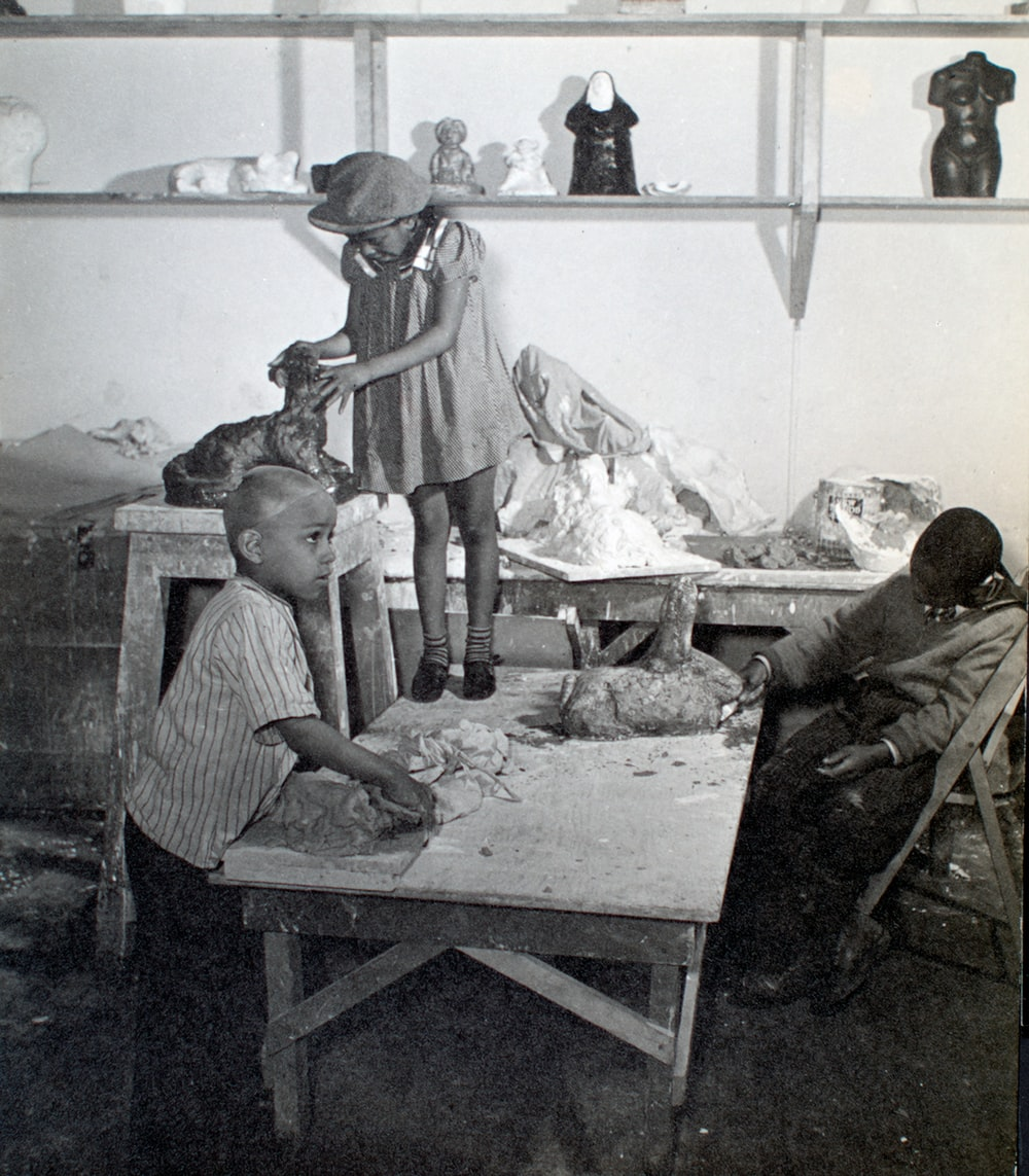 Young children in sculpture studio working with clay