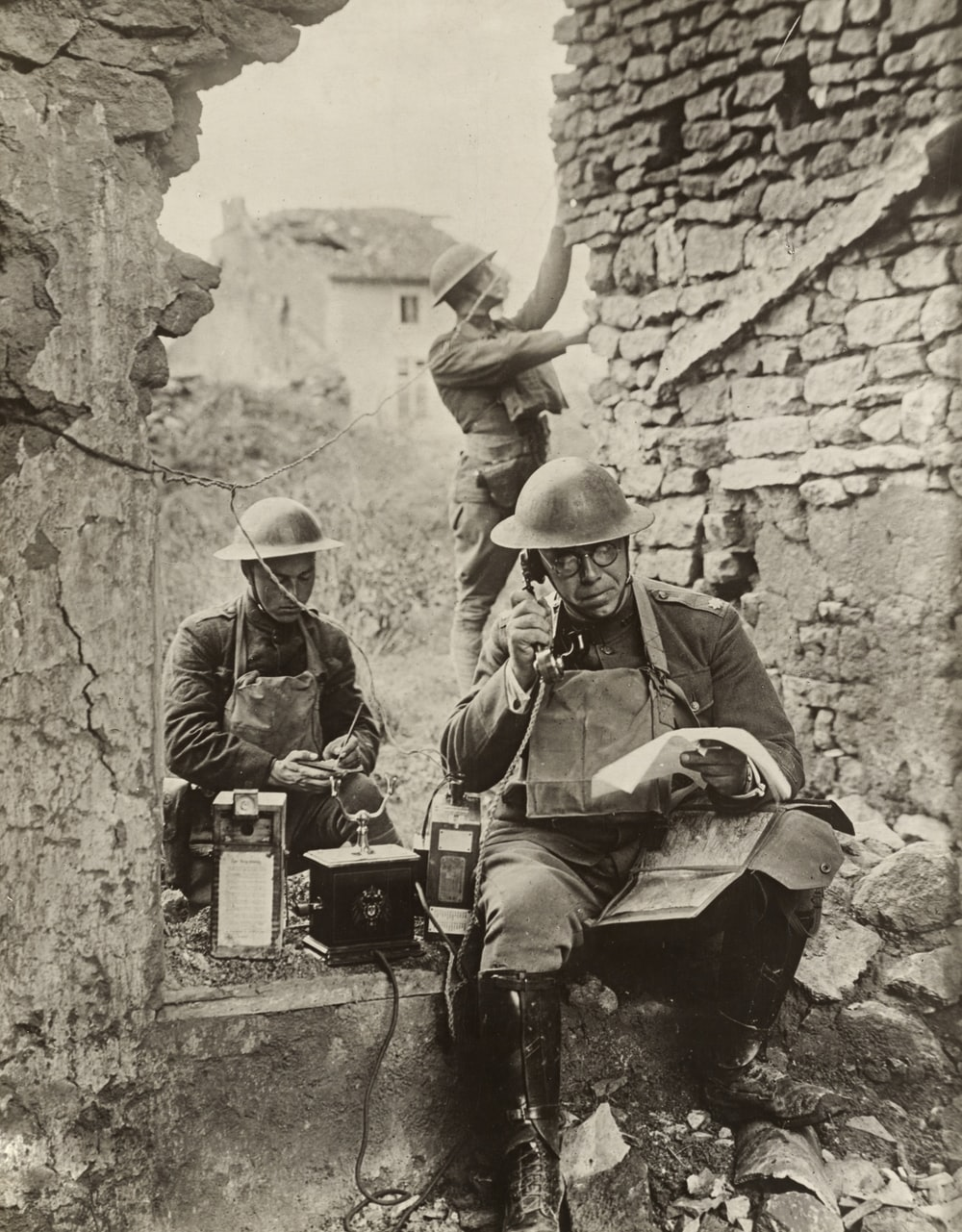 grayscale photo of 2 male soldiers in World War 1 on the telephone