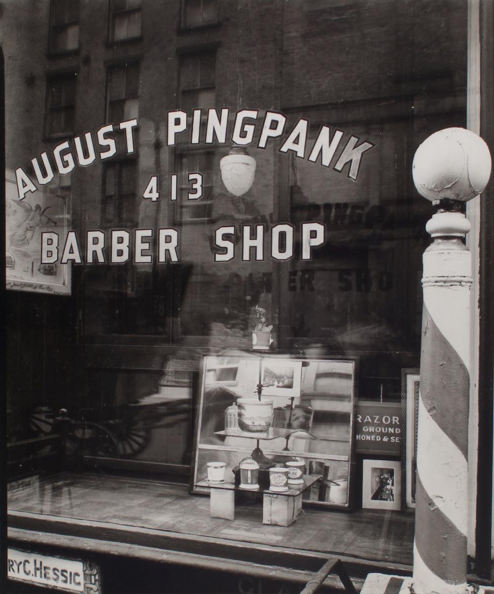 grayscale photo of barber shop window
