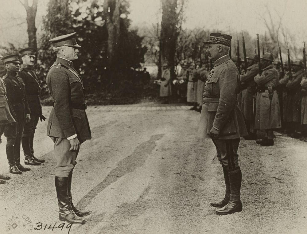 grayscale photo of 2 men in military uniform