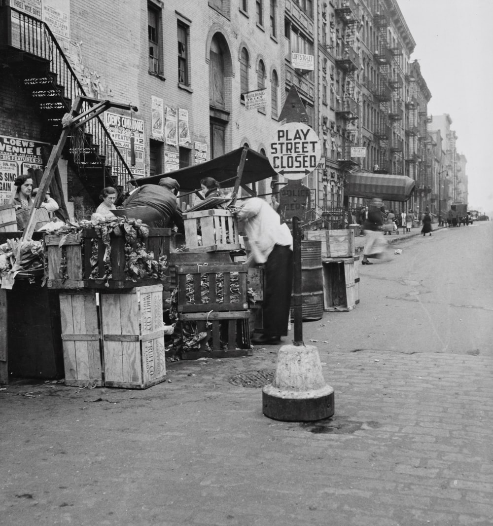grayscale photo of a busy street in New York City
