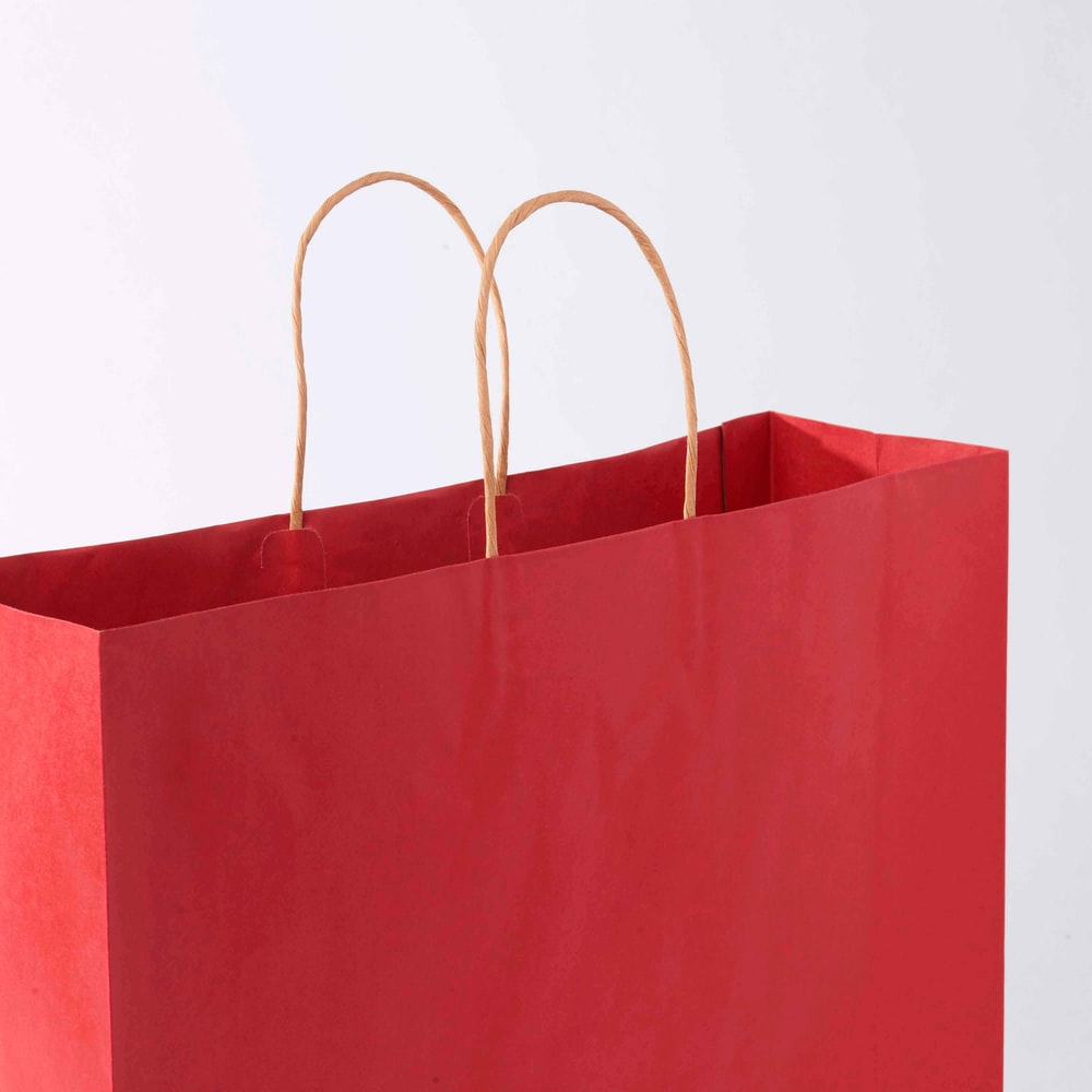 red paper bag on white surface