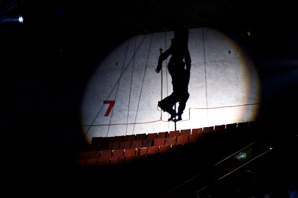 silhouette of man walking on tunnel