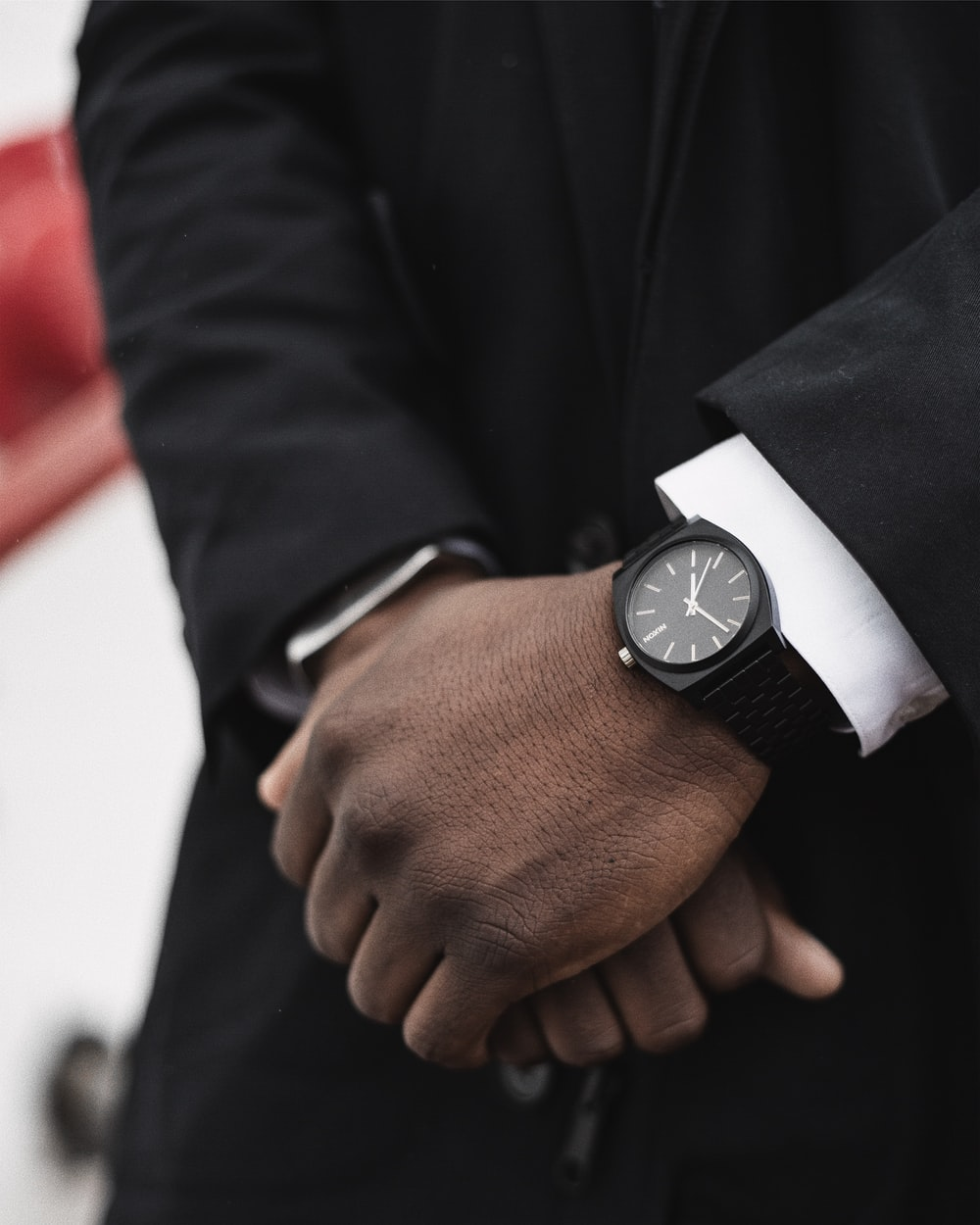 person wearing black and white analog watch