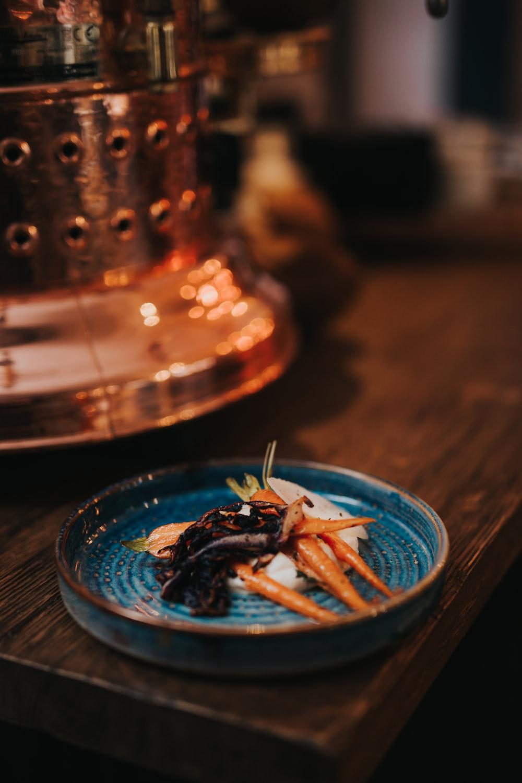 brown sticks on blue glass bowl