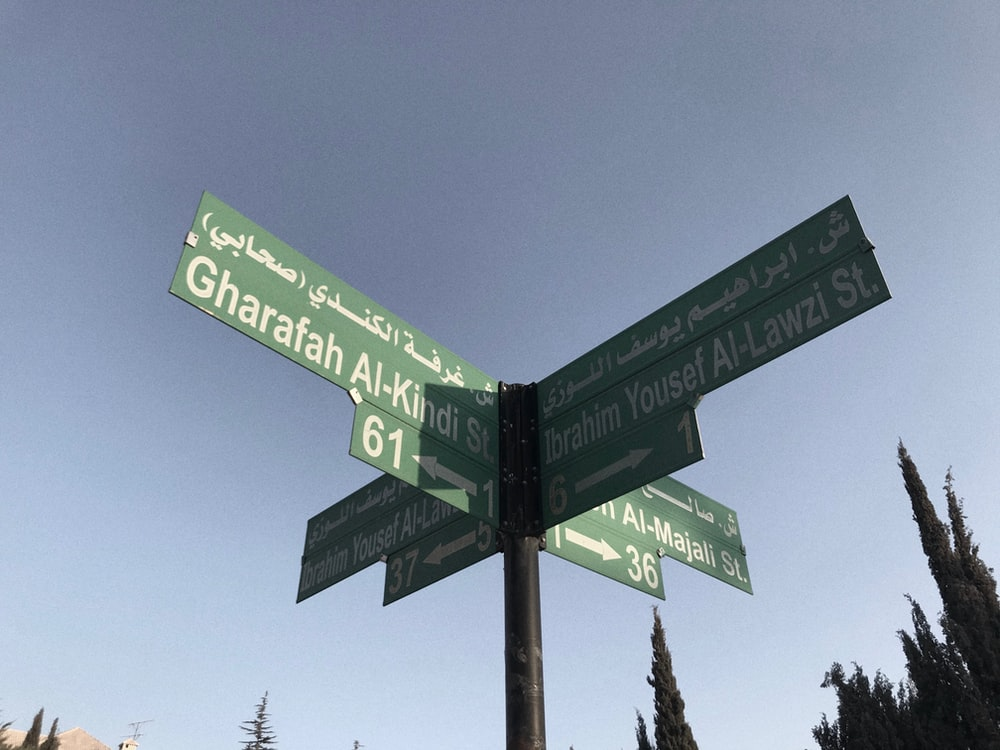 green and black street sign