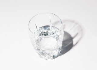 clear glass cup with water