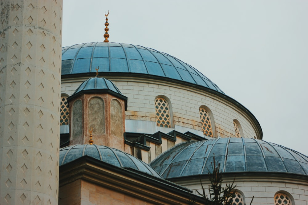gray and green dome building