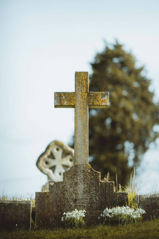 grey cross with cross on top