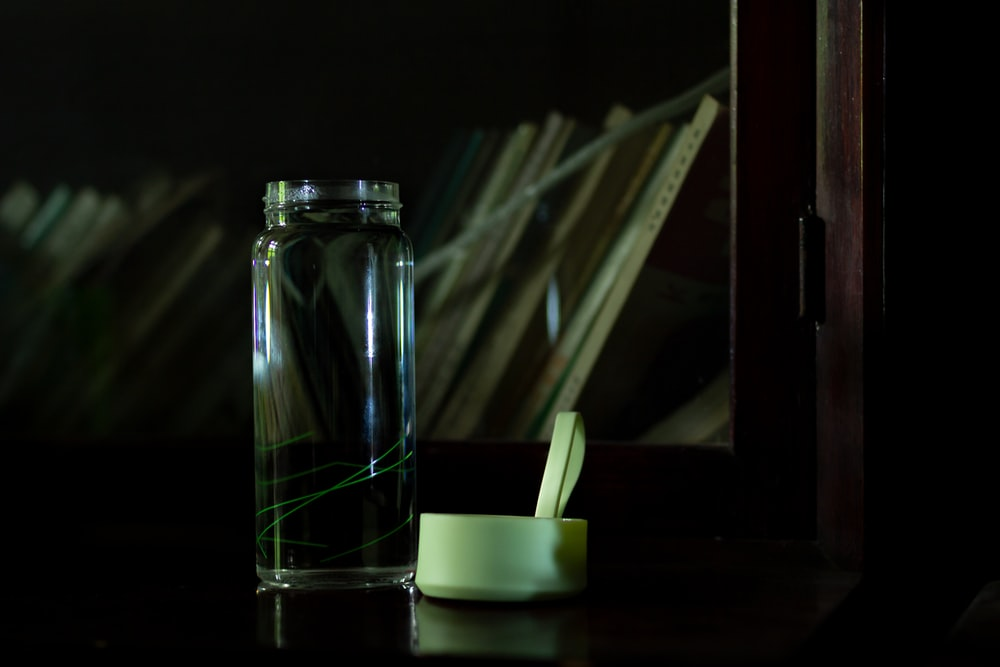 clear glass jar with white plastic spoon