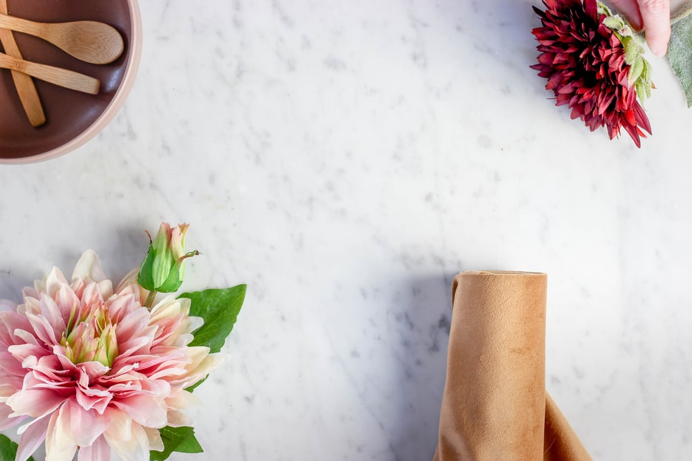 pink and white flower on brown paper bag