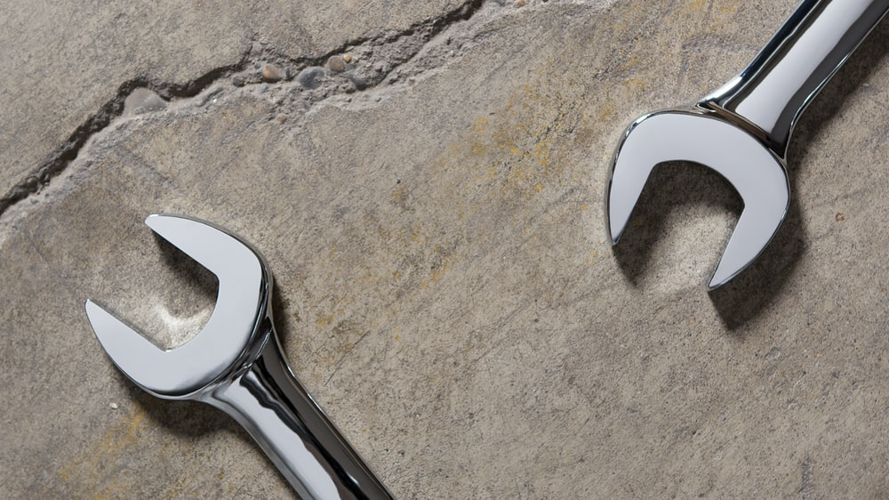 stainless steel tool on gray sand