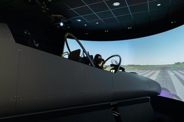 Female aerospace engineer conducts flight simulator