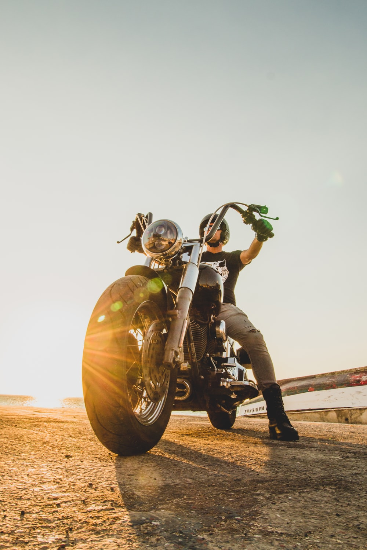man in yellow helmet riding motorcycle during daytime