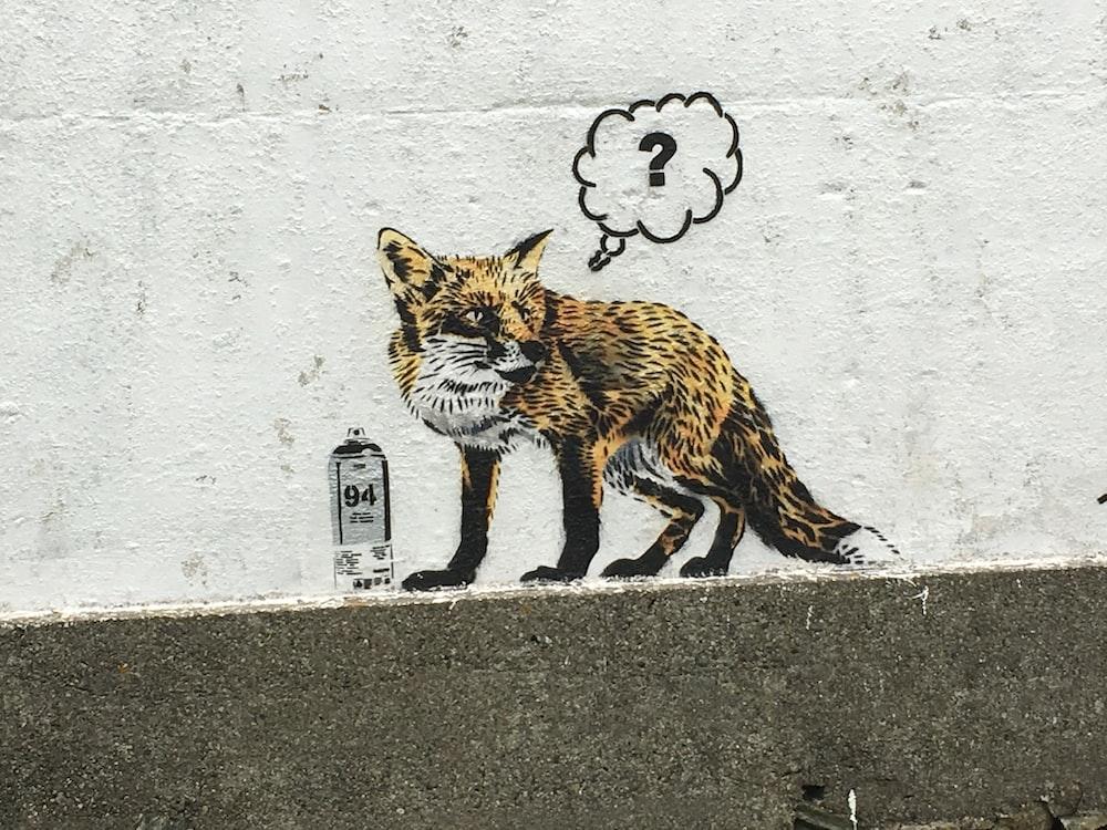 brown and black fox wall art