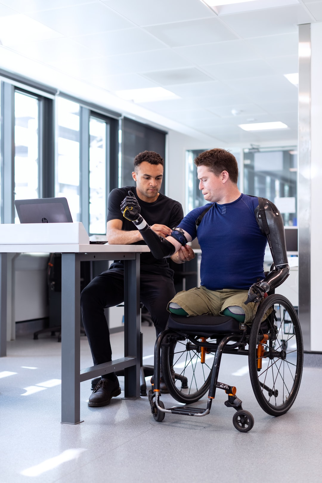 Male mechanical engineer fits prosthetic limbs