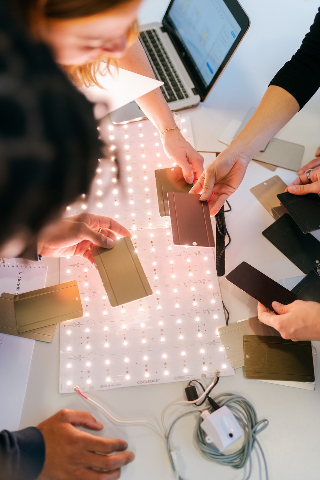 Female electrical engineer test materials for lighting with team