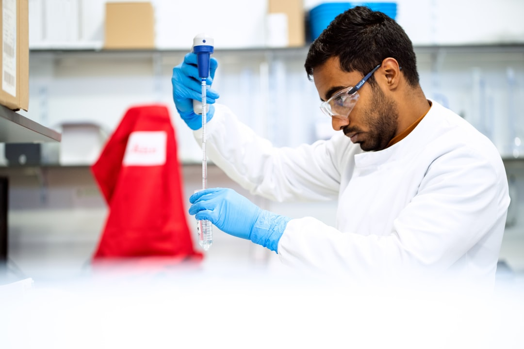 Male biomedical engineer conducts medical experiment