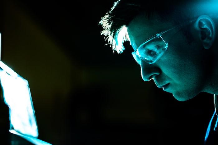 A man ans a computer