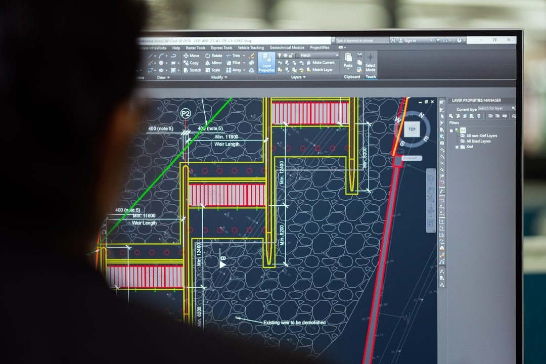 Female civil engineer designs weirs on computer
