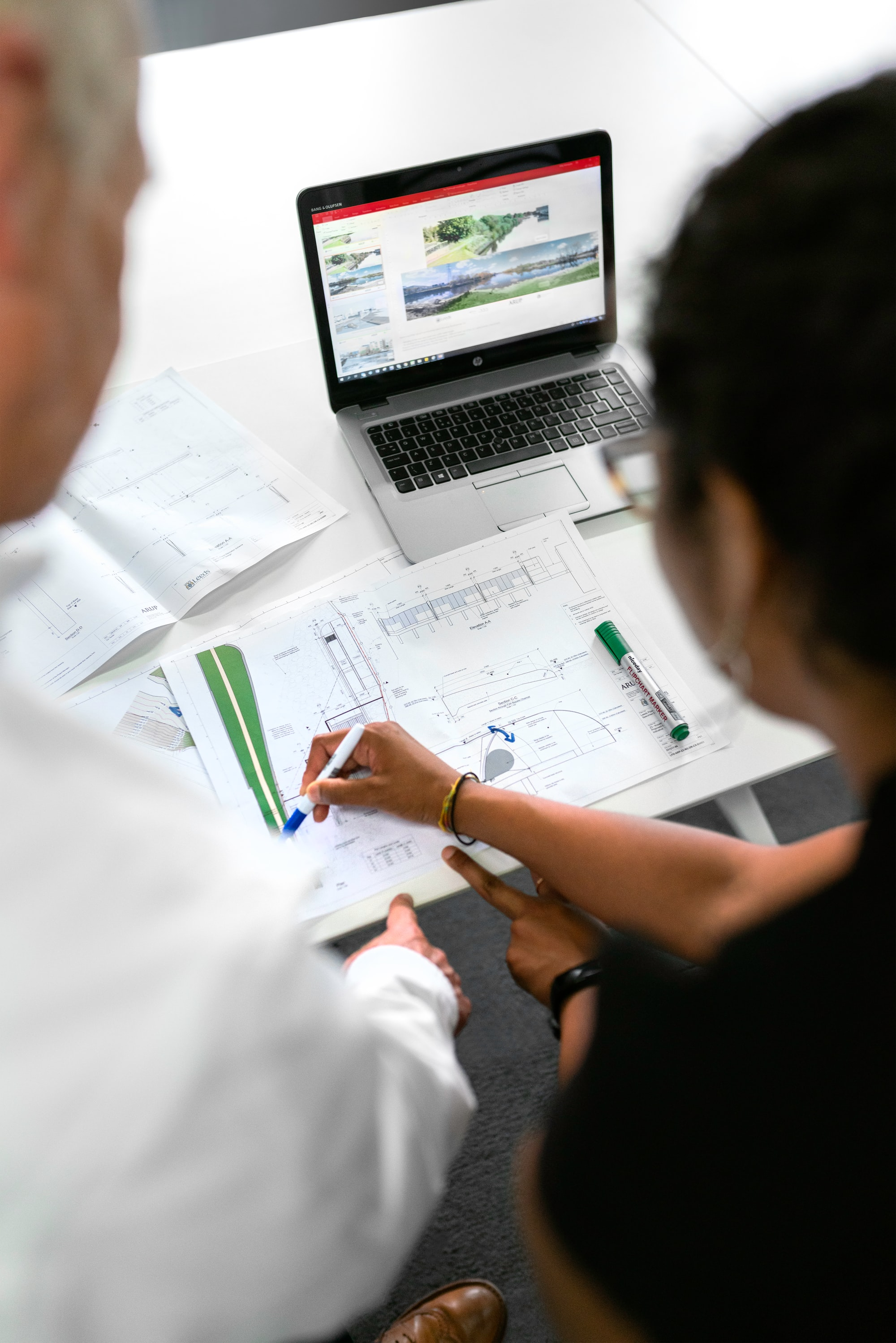 Female civil engineer discusses flood risk management plans with colleague