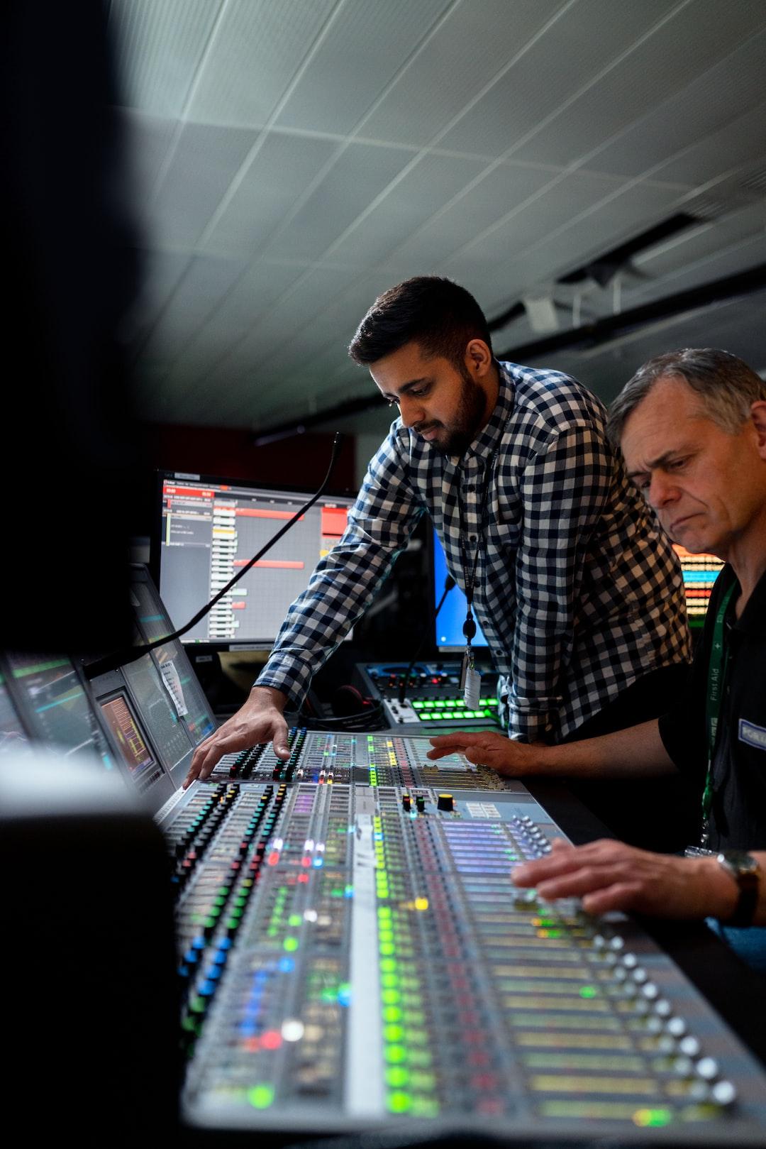 Broadcast engineers work in studio