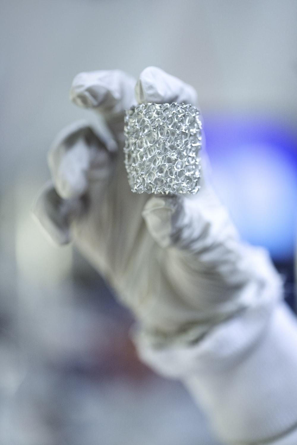 silver diamond studded ring in white flower