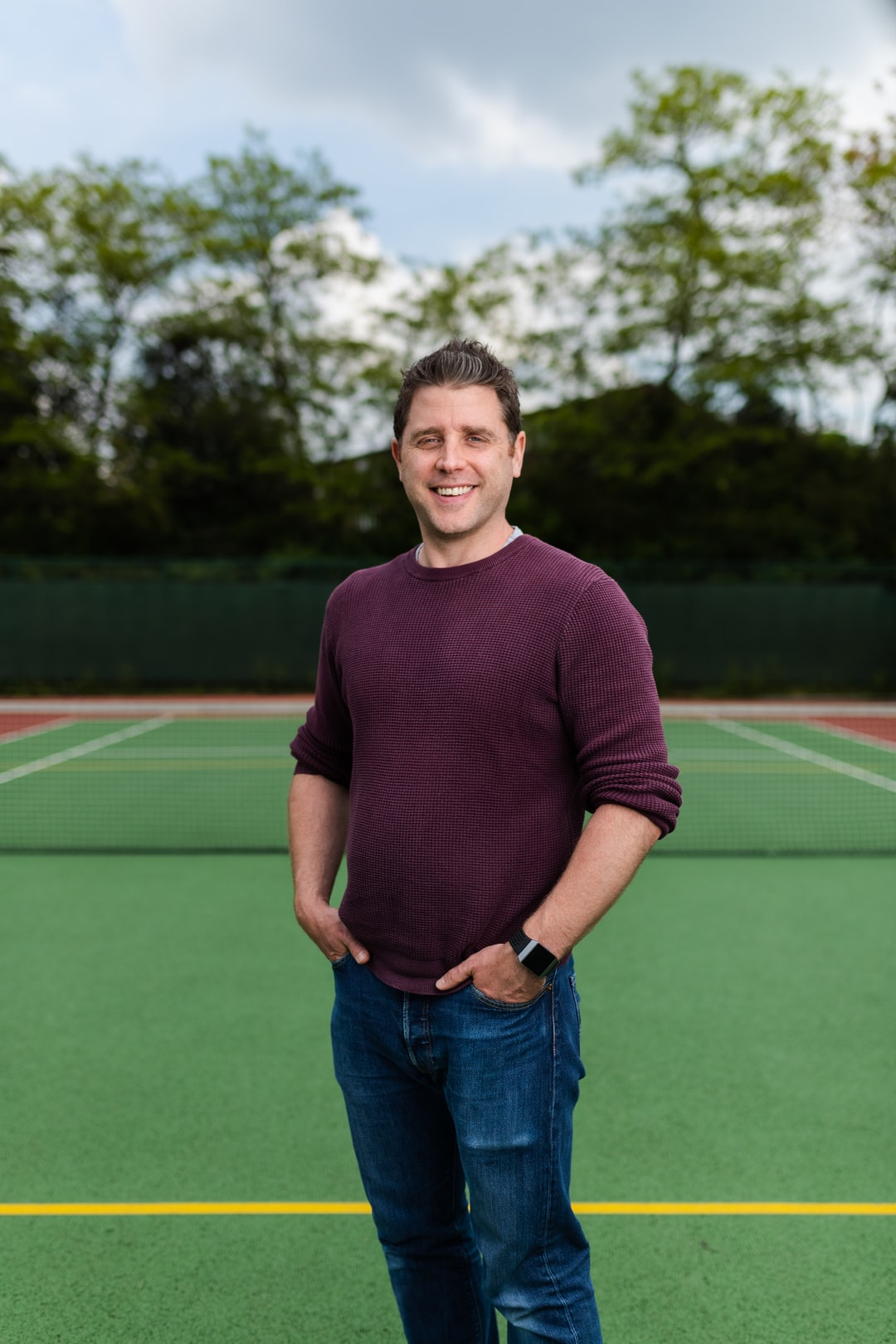Male sports engineer on tennis court