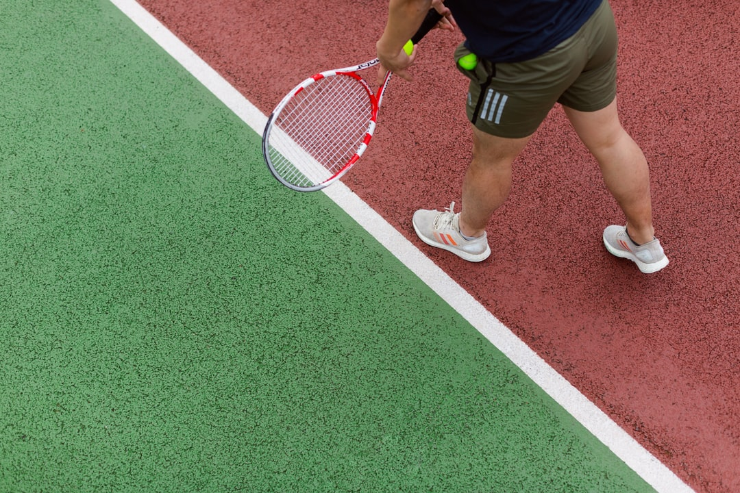 Male Sports Engineer Tests Tennis Equipment - unsplash