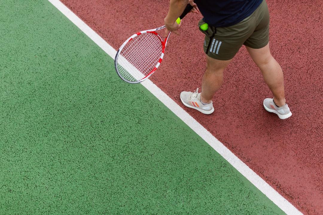 Male sports engineer tests tennis equipment